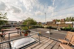 The roof terrace is accessed via a bespoke stair made from birch ply and steel…