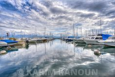 Fine Art Prints Daramatic sky reflection with boats in the middle Photographe Lausanne