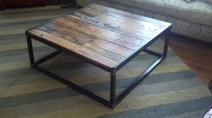 Salvaged oak coffee table with welded steel frame