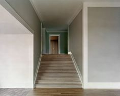 White panels line the corners of each of the rooms, while wooden boards cover the floor throughout the house