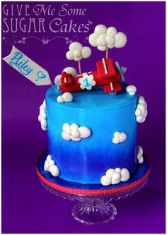 """""""Sky High"""" - This little number was for a 1st Birthday party celebration.  Fondant decorations, including the aeroplane, on an airbrushed cake."""