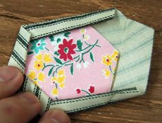"""making already-quilted hexies(smaller inner hexie and outer """"frame""""....with batting in between, cut, fold over 2ce, then stitch all round.  Zigzag to join hexies together.  Love."""