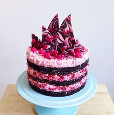 chocolate brownie cake, layered with raspberry cream & crushed rose water meringue.