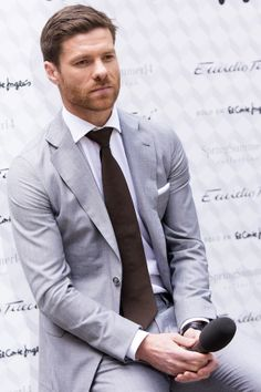 Xabi Alonso in a classic, grey suit.