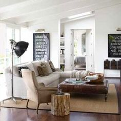 In this photo: Friedman bought her living room's London bus signs and 19th-century tea tins at a local antiques store. She paired a linen sectional by Verellen and an 1890s leather chair with a Restoration Hardware ottoman. The nickel lamp is by Visual Comforts.