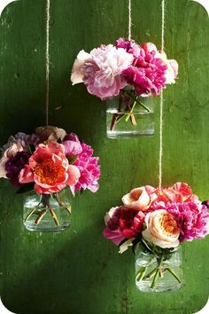 Flying flowers..cute idea to hang behind a food table or from a light fixture over the table-- for a shower!