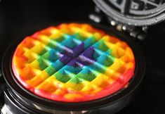 Rainbow waffles on a waffle iron - Mmmm, taste the crispy rainbow. Must get hubby to make these...