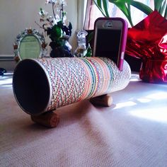 DIY portable iPhone speaker made from Pringles can, decorative paper, w/detachable wine cork stand.