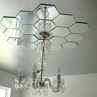 DIY mirrored ceiling medallion by Bella Tucker Decorative Finishes. With candle plates from hobby lobby