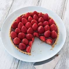 Strawberries are one of the best parts of summer! I want this Strawberry-Chocolate Truffle Tart.