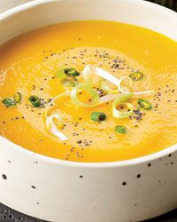 Creamy Carrot Soup with Scallions and Poppy Seeds | Marcia Kiesel's luxuriously creamy soups are the perfect starters for Thanksgiving dinner because they can be made in advance, then reheated and garnished just before serving.