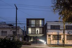arquea arquitetos adds wooden curtain to brazil's building