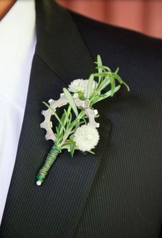 A bike loving groom had a cog put in his boutonniere. We love this unexpected element!