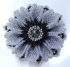 beaded flower (bead/pearl center)