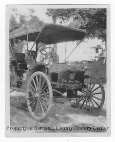 This little kid is so cute!!  1910 image of the Belle Haven Inn vehicle.  Sarasota, FL.  (Sarasota County History Center)