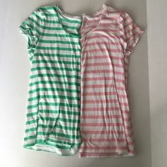Two well loved Ann Taylor striped tees Love love love these Ann Taylor striped tees. But they are not long enough for my post baby body. Both green and white striped and pink and white striped shirts come in bundle. Soft and in great shape! Ann Taylor Tops Tees - Short Sleeve