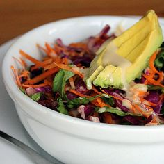 Detox Deliciously With a Colorful Veggie Salad Calories (with dressing, including a quarter of an avocado): 275 High in fiber, vitamin C, and vitamin A, this raw rainbow salad will add some color and flavor to a day of detox. The water content in romaine works to hydrate your body while the high fiber content in the red cabbage and carrots aids in healthy digestion