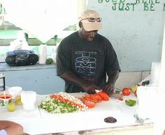 A local vendor making conch salad in Marsh Harbour, Abaco, The Bahamas