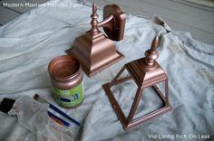 Two coats of Modern Masters Copper Penny Metallic Paint on an exterior light | Transform Your Exterior Lights by Living Rich On Less
