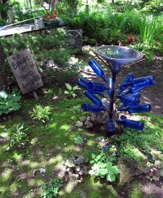blue bottle tree with bird bath.  Another note to self:  drink more blue wine unless buy one from this guy