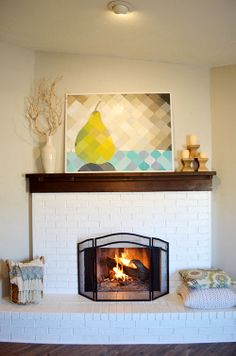 The Happy Homebodies: Art & Fire    pixelated pear artwork above a white painted brick fireplace