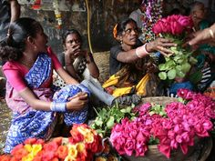 Photograph by Palani Mohan/Getty Images  Vendors sell bouquets at the flower markets near the Mahalaxmi train station in Mumbai.