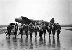 Aircrew of No. 106 Squadron in front of a Lancaster at RAF Syerston, after raiding Genoa, October 1942