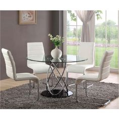 https://i.pinimg.com/236x/f4/bf/7a/f4bf7a18c5fec9c53aceda16f1fd0f92--round-dining-room-tables-glass-dining-table.jpg