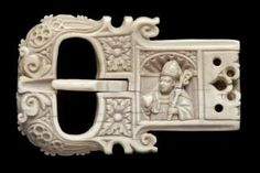 Belt buckle (ceinture) (Front): Male, St Trudo's Abbey S/n Ivory Height: 47mm Width: 68mm Depth: 9mm Saint Augustine of Hippo, as a bishop, with mitre, crozier and a heart. Foliated decoration. Scallop shell niche. Flamboyant tracery. Bruges 2010: Northern France or Flanders, 1st half of the 16th century.