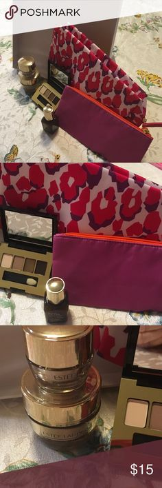 Estée Lauder Makeup Bag & Products NEW All new this make up bag by Estée Lauder comes with some of the best products. The zipper up make up bag has a smaller pink bag that goes inside. Products include an Eye shadow box with the color shown; they're famous advanced night repair .5 ounces, revitalizing supreme cream in travel size and A second larger revitalizing cream. I opened the revitalizing cream to make sure that the store had not been using it however I did not use it. Estee Lauder…