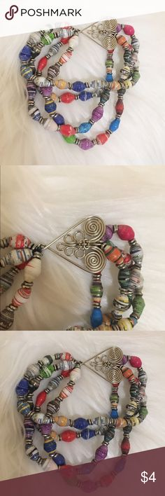 Beaded layered bracelet Bracelet with a silver heart design. Worn a few times! Has a layered thing going on. Really colorful and artsy. Jewelry Bracelets