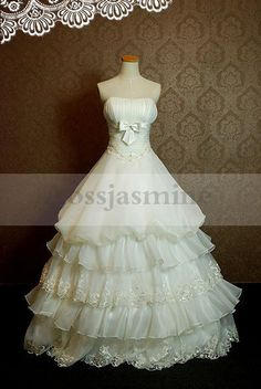 Attractive strapless sashes appliques multilayer ball gown organza wedding dress