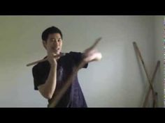 eskrima double stick figure 8 with arm weaving