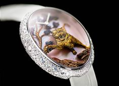 """VAN'T HOFF's """"Time of the Tiger"""", is a remarkable single edition ladies' watch. The tiger, in Chinese tradition, is considered the King of all beasts! Grand Prix, Tiger Art, Art Watch, Japanese Prints, Three Dimensional, Rings For Men, Carving, Pure Products, Van"""