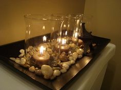 Details Make a Difference-The final detail in adding that spa like feeling to your bath? Add candles! Candles add that magical glow that makes that long soak in the bath special. Consider creating a wall grouping of candles for dramatic effect. Or create unusual holders, such as old chandelier light shades.(Keep the matches nearby, you'll want to light these often!)