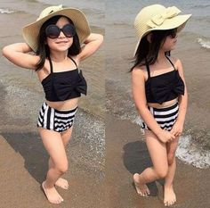 Descripción Department Name:Children,Decoration:None,without Necklace,Item Type:Bikini Set,Pattern Type:Stripe,Gender:Girls,Style:Fashion,Material:Cotton,Polyester,Collar:O-neck,Sleeve Length:Sleevele