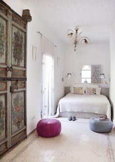 Antique Moroccan doors in a bedroom suite in Riad P'tit Habibi in Marrakech.