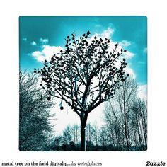 metal tree on the field digital photo blue tint