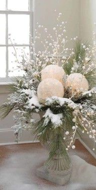Planter/centerpiece of lit snowballs, snowy pine, berries and branches