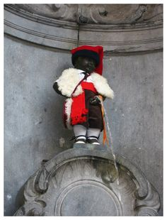 Brussels - Belgium. The Manneken Pis has more than 600 costumes and they changed his clothes every week.  Among the more special costumes are for instance : an Elvis Presley outfit and a Mickey Mouse costume, Christmas Noel too...