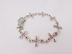$12.00 - Zebra Crosses. Great quality bracelet with silver-tone hardware and zebra striped crosses.  #PINKBracelets #PINK #Bracelets #PINKPixie #Nonprofit    All of our proceeds go to educating women in crisis. www.pinkpixie.org