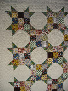 I never tire of scrappy or the secondary pattern provided by the alternate snowball block