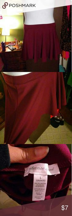Burgundy skater skirt Its smaller than a large but its a pretty color I wore it once Skirts