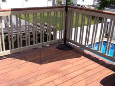 Finished deck and railings offset rail Benjamin Moore semi transparent on deck and Ben Moore arbor coat solid on railings I like the two tone and top rail finish all top rail was 2x6 with route red edge and sanded. By integrity home improvment