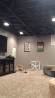 Paint for exposed ceiling in basement: Sherwin Williams Caviar. (Flat, two coats)