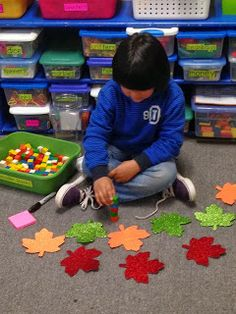 Chalk Talk: A Kindergarten Blog: When the Leaf Blew InI placed leaves in our counting jar this week. I found this large sparkly leaves at Walmart.   This idea came from Investigations. Students count how many objects are in the counting jar. Then they make a set of the same number using another object. Then they record how many were in the set they counted and made on a post it. This student made his own set by stacking cubes into a tower. Then he drew a picture of 9 things on a post-it.
