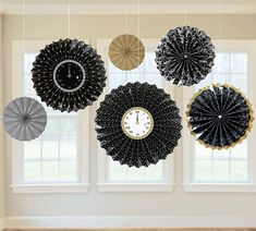 Hanging paper fans with clocks for New years eve!:
