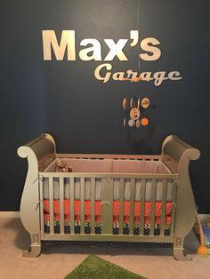 Bratt Pack Mom, Janna McFarland, designed the ultimate boy nursery for her son, Max, with the theme of vintage trucks. #brattdecor