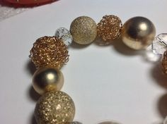 Pretty beaded bracelet. Gold color and slides on easily.
