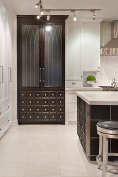 Joy Tribout Interior Design ALL WHITE BUILT IN ON EITHER SIDE OF STAINLESS STEEL REFRIG